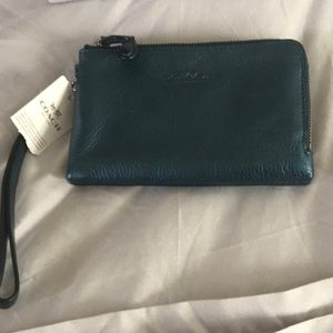 Metallic Blue Coach Wristlet
